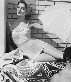 Suzy Parker in Jacques Fath polka dot swimsuit, parasol and headband from 1954.  Photo by Henry Clarke.