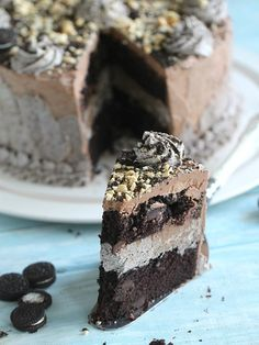 An Eggless Oreo Nutella Cake with chocolate chips, roasted hazelnuts, Oreo buttercream and Nutella Buttercream for the most amazing cake.