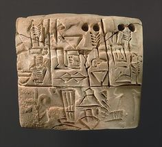 Administrative tablet with a Sumerian inscription and a cylinder seal impression.    Mesopotamia, Jemdet Nasr period (ca. 3100–2900B.C.), probably from Uruk.
