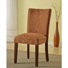 Complement your dining table with this stylish fabric dining chair. Its fabric is designed in hues of red and gold, ensuring a perfect match with any wooden table finish. Its solid wood legs and frame ensures a sturdy chair that can stand constant wear.