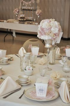 Coffee filter flower centerpieces for a bridal shower! Cheap idea. This bridal shower had 140 people-- 12 tables and a candy buffet. :)