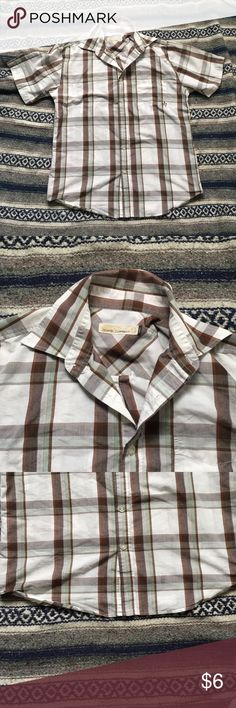Plaid button up shirt Guys plaid button up shirt . Only been worn once , has a tiny spot at the bottom or the shirt but isn't noticeable while on Ocean Current Shirts Casual Button Down Shirts