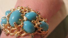 Vintage Jomaz Chunky Gold tone faux turquoise Cuff bracelet. $ 60.00, via Etsy.
