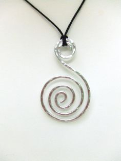 Spiral Pendant Aluminum Pendant Wire Wrap Pendant Hammered Metal Pendant Jewelry Gifts Under 20 Artisan Handmade. $14.95, via Etsy.
