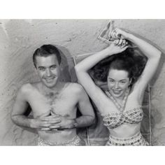 Overhead portrait of young couple relaxing on beach Canvas Art - (18 x 24)