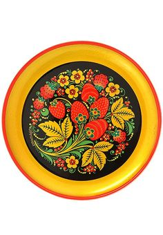 A wooden plate decorated with folk Khokhloma painting from Russia. #Russian…
