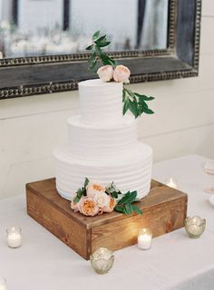 Textured three tier peach floral topped wedding cake: http://www.stylemepretty.com/2016/09/10/blush-pink-pippin-hill-vineyard-wedding/ Photography: Michael and Carina - http://www.michaelandcarina.com/