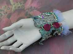 Etsy の Iolanthe cuff bold cuff with antique laces by FleursBoheme