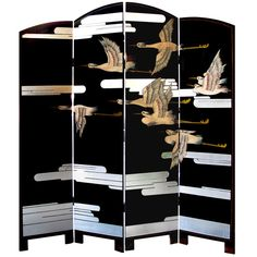 A chic American art deco 4-paneled lacquered screen depicting a soaring flock of birds; the arched black lacquered screen adorned with gracefully flying birds amid stylized clouds with great horizontal movement. United States,   1930s. I want this!