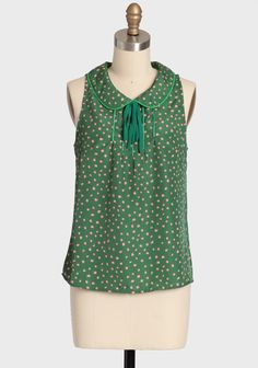"""Forest Dewdrops Printed Top 32.99 at shopruche.com. Get dressed up in vintage-inspired style with this silky green top that is perfect for work, school, or the weekend. Finished with a charming peter pan collar, a decorative necktie, a dainty pink print, and a back button keyhole closure.100% Polyester, Imported, 23.5"""" length from top of shoulders, 36"""" bust, All measurements taken from a size small"""