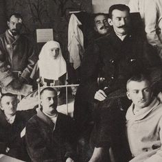 """Grand Duchess Tatiana Nikolaevna Romanova of Russia with wounded soldiers during WWI in 1914.  """"AL"""""""