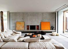 comfy sofa + concrete walls + fireplace w/ side log storage