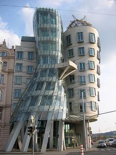 """Ginger and Fred"" or more commonly known as the ""Dancing House"" in Prague, Czech Republic, designed by Frank Gehry  This building has almost a very magical feel to it, like it jumped straight out of a cartoon"