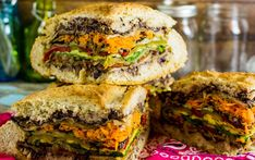 A muffuletta is is a sandwich that has origins among Italian immigrants in New Orleans. This version eschews the meats and cheese and is all veggie, baby!