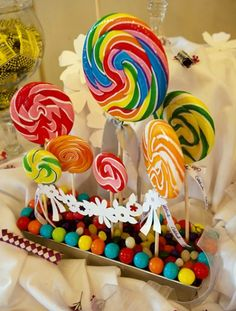 lollipop centerpiece - can mix in the Mickey cake pops. I love the little banner idea!