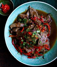 Beef with black bean and chilli sauce recipe - For marinade, combine Shaoxing, sugar and 1 tsp sea salt flakes in a large bowl. Add beef, stir to coat and refrigerate for 30 minutes.