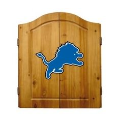 This NFL Detroit Lions Wooden Dartboard Cabinet Set is made of solid  pine and makes a great gift for the sports fan in your life. This  officially licensed dartboard comes with mounting hardware and six team  logo darts.   Great gift for sports fan Perfect for man cave or garage Made by Imperial International Solid pine wood dartboard cabinet All natural 18-inch bristle dart board Mounting instructions and hardware included Six steel darts with team logo on flights Includes chalk and eraser…