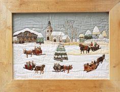 Un paysage d'hiver en tissus appliqués