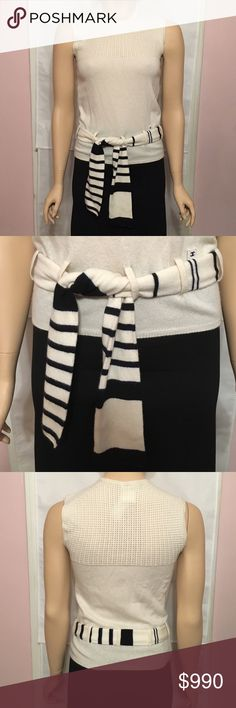 CHANEL Cashmere top Ivory Fr 38 Ivory CHANEL sleeveless top with open knot contrast at yoke and ivory and black belt at waist.  100% Cashmere, in Very Good+ Condition with faint wear throughout. CHANEL Tops