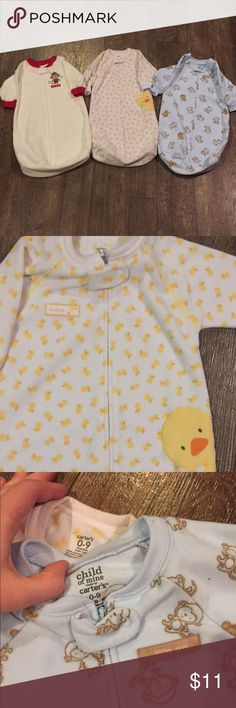 "Carter's 0-9m sleeping sacks gowns bundle lot Carters sleeping gowns/zip-up sacks. Total of 3. All size 0-9m. No stains that I saw. Sleeves on duckie zip-up have some ""fuzzies"" as pictured. These are great for middle of the night diaper changes and to keep baby warm without fear baby kicking a blanket over their face.     Bundle to save! Make an offer! Carter's Pajamas Sleep Sacks"