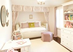 Girls room. The fabric framing the bed is gorgeous as is the stool.