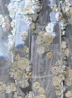 Roses on silk....beautiful!  I wonder what it is and what it was used for...