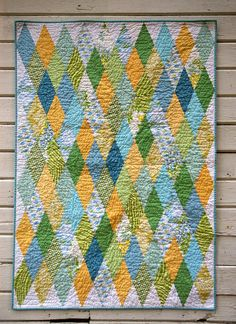 love this quilt.  Thought each diamond was 2 triangles, but now I think the diamonds are whole?