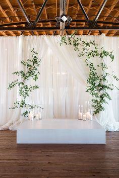 Rustic Draped Wedding Ceremony Backdrop with Modern Greenery and Candles #weddingdecoration
