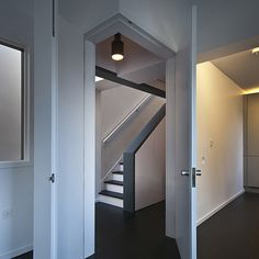 Long staircase spans converted London<br /> apartment by Patalab Architecture