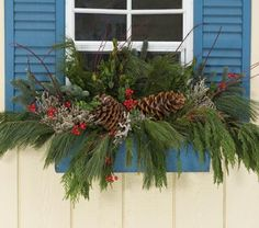 winter flower box - fresh Incense Cedar, Noble Fir, White Pine, Boxwood, Red Dogwood, large Pine cones, white Statice, and faux red berries