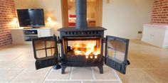 Cute wood burning stove makes a great feature fire in the living room.