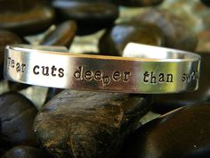 Game of Thrones inspired bracelet - Fear cuts deeper than swords. $15.00, via Etsy.