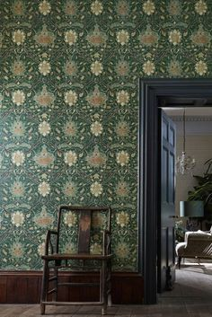Inspired by a Persian carpet design, this late 19th century pattern is recreated as a wallpaper, whilst still retaining the look of woven fabric with a decorative trail.