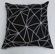 Black throw pillow and cushion cover with graphic design