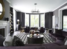 Large velvet purple sectional in a curved living room | 11 Rooms from Interior Designer Greg Natale