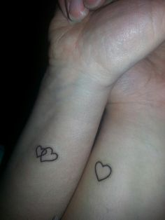 Mom and I got our mother daughter tattoos today. She got two heart connected to symbolize my brother and I. I love them! motherdaughter tattoo inked motherdaughtertattoos heart tattoos