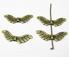 Antique Bronze Angel Wing 8x23mm