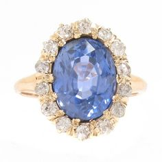 1910's 14k, Sapphire & Diamond Cluster Ring - This 1910's cluster style ring is crafted in 14 karat yellow gold and features one 3.82 carat sapphire surrounded by 0.40 carat of Old Mine cut diamonds.  The sapphire has not undergone any heat treatment. -                                                                                           $8,900.00…