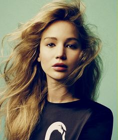 Jennifer Lawrence looks so different in this picture. I love her hair color and the messy curl pattern