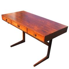 Vintage Midcentury Georg Petersens Rosewood Desk   From a unique collection of antique and modern desks and writing tables at https://www.1stdibs.com/furniture/tables/desks-writing-tables/