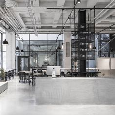 Dine, wine, and file into an assembly line at Stockholm's Usine, where  interior designer Richard Lindvall has stripped down a former factory into  a streamlined aesthetic.