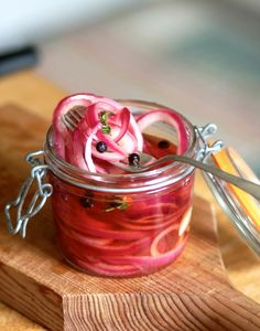 If you were to peek into my refrigerator any day of the week, any season of the year, you would surely find a jar of pickled red onions. This bright, jewel-toned condiment offers a zesty tang to countless dishes and adds a lovely splash of color as well. It takes about 10 minutes to assemble and lasts for weeks in the refrigerator. What more can you want from a pickle?