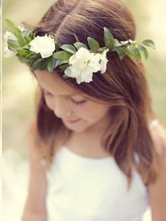 The flower girls will have halos of greenery with accents of ivory spray roses.