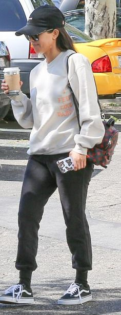 Who made  Kourtney Kardashian's black pants, sneakers, sweatshirt, and red print backpack?
