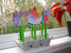 Tulip garden.  egg carton, playdough, glue, watercolors, popsicle sticks.  Put a dab of glue in bottom, add dough , paint your tulips, then plant them into dough!