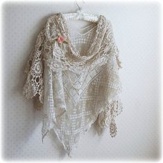This lace shawl includes a long crochet scarf. It is made of very delicate but sturdy vintage Tuscan lace, in which texture is woven into the