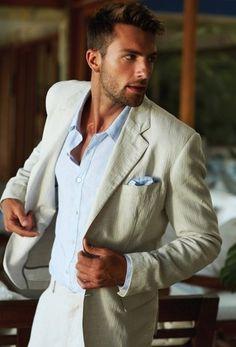 Men's Light Blue Dress Shirt, Light Blue Silk Pocket Square, Beige Blazer, and Beige Dress Pants
