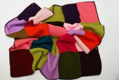 Multicolour hand knitted patchwork blanket by Minuko on Etsy, £54.99