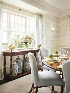 great ideas for the formal dinning room with the white and trim on bottome and wallpaper on top