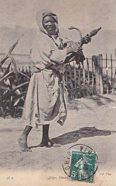 Vintage Moroccan Gnawa musician.The instrument is actually an Imzad not a guembri or hajhouj.